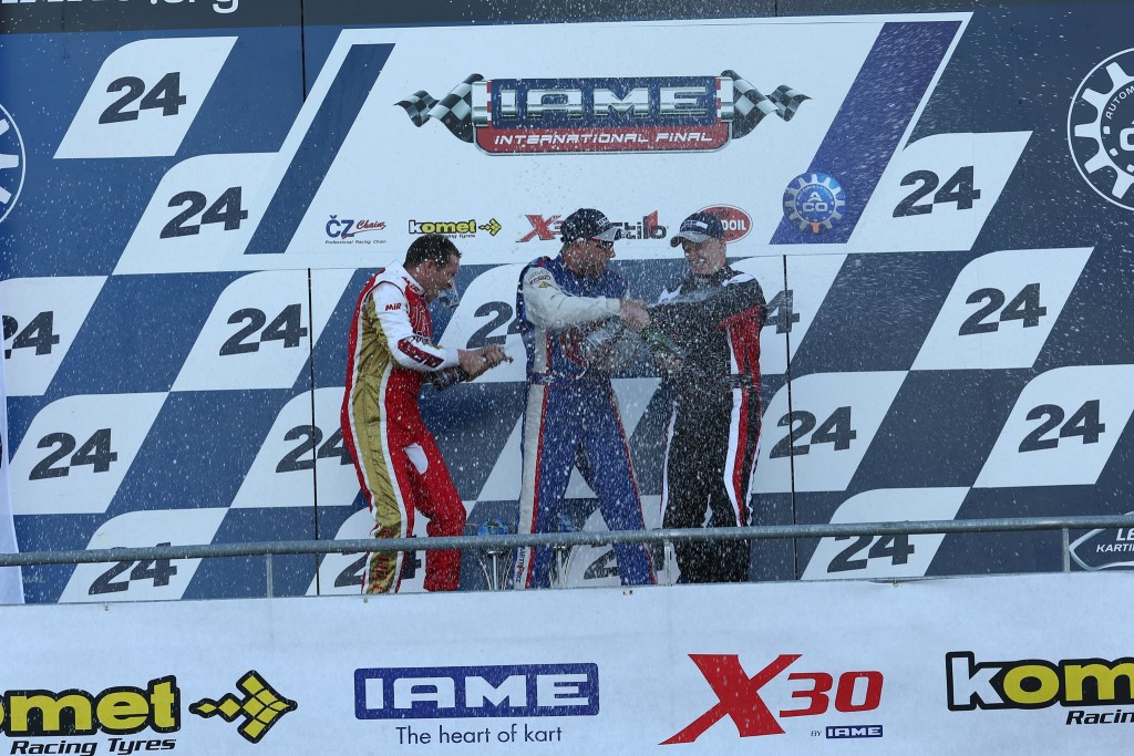 Kip Foster celebrating on the podium at the 2014 IAME International Final