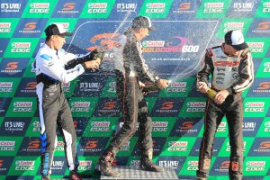 Davide Forè (centre) celebrating on the podium with Marijn Kremers (left) and Kyle Ensbey (right).  Pic: Coopers Photography