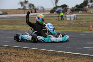 Reece Sidebottom crossing the line for victory in the KF3 class (Pic: Coopers Photography)