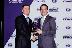 Dr Brent May (right) receiving his award from World Motor Sport Council Member Garry Connelly