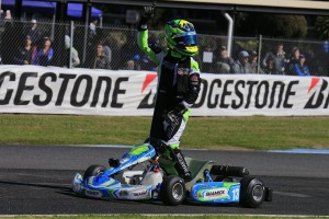 James Wharton applies the #1 to his kart after this afternoon's final